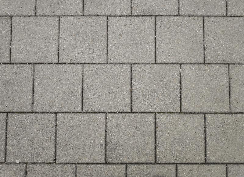 Γκρίζο πάτωμα δομών συγκεκριμένων κεραμιδιών στοκ φωτογραφία με δικαίωμα ελεύθερης χρήσης
