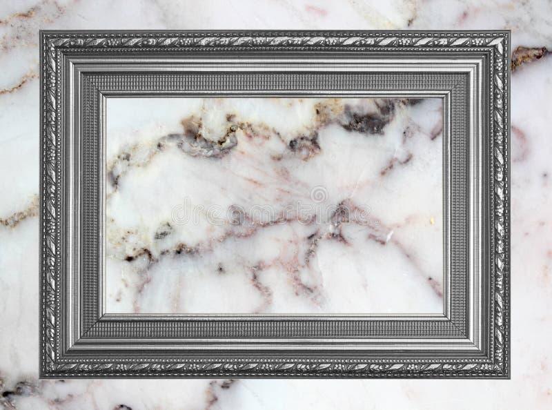 Γκρίζο πλαίσιο φωτογραφιών πλαισίων εκλεκτής ποιότητας στο μαρμάρινο υπόβαθρο τοίχων πετρών στοκ εικόνες με δικαίωμα ελεύθερης χρήσης