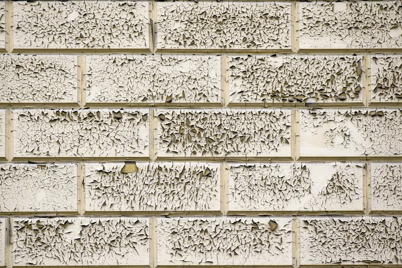 Γκρίζο ραγισμένο και χρώμα αποφλοίωσης σε έναν παλαιό βρώμικο τουβλότοιχο Παλαιά αφηρημένη σύσταση χρωμάτων Δομή του εκλεκτής ποι στοκ φωτογραφίες με δικαίωμα ελεύθερης χρήσης