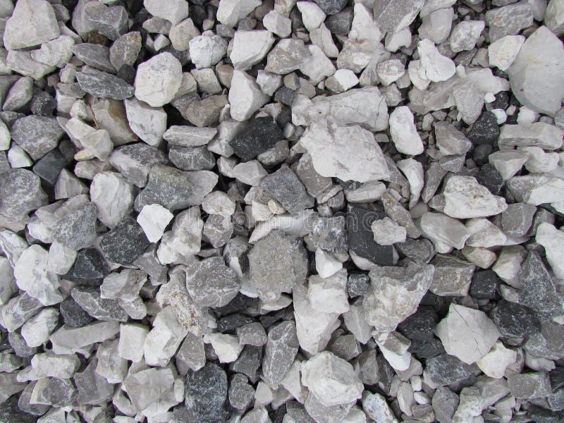 Γκρίζο συντριμμένο τόνοι υπόβαθρο βράχου στοκ φωτογραφία