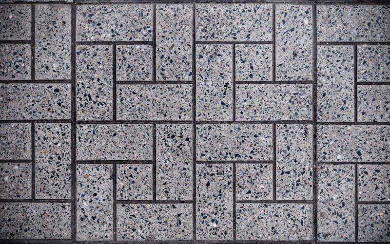 Γκρίζο τετράγωνο που στρώνεται με τις μικρές τετραγωνικές γωνίες και τα γκρίζα ορθογώνια Άνευ ραφής σύσταση Tileable στοκ εικόνες