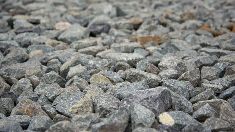 Γκρίζο υπόβαθρο κινηματογραφήσεων σε πρώτο πλάνο πετρών αμμοχάλικου στοκ εικόνες με δικαίωμα ελεύθερης χρήσης