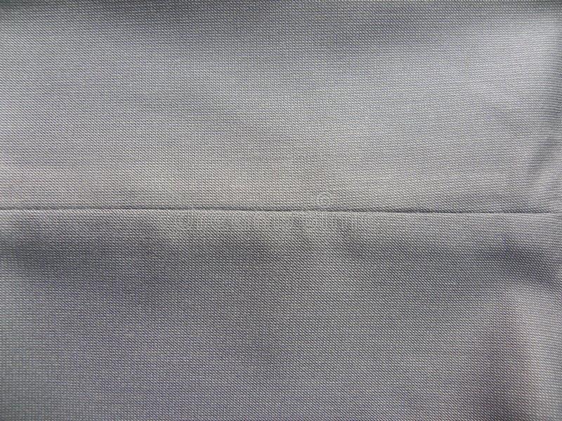 Γκρίζο ύφασμα βαμβακιού με τη ραφή στη μέση στοκ εικόνες με δικαίωμα ελεύθερης χρήσης