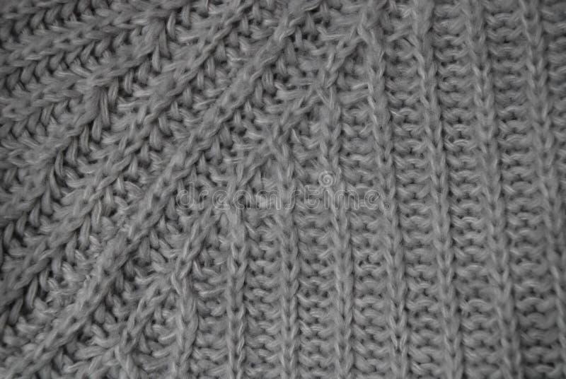 Γκρίζο knitwear υπόβαθρο στοκ φωτογραφία με δικαίωμα ελεύθερης χρήσης