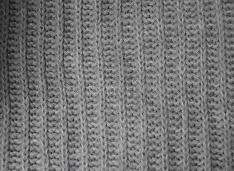 Γκρίζο knitwear υπόβαθρο στοκ εικόνες