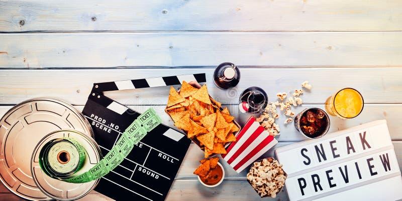 Γλιστρήστε την έννοια εμβλημάτων πανοράματος πρόβλεψης ταινιών στοκ εικόνες