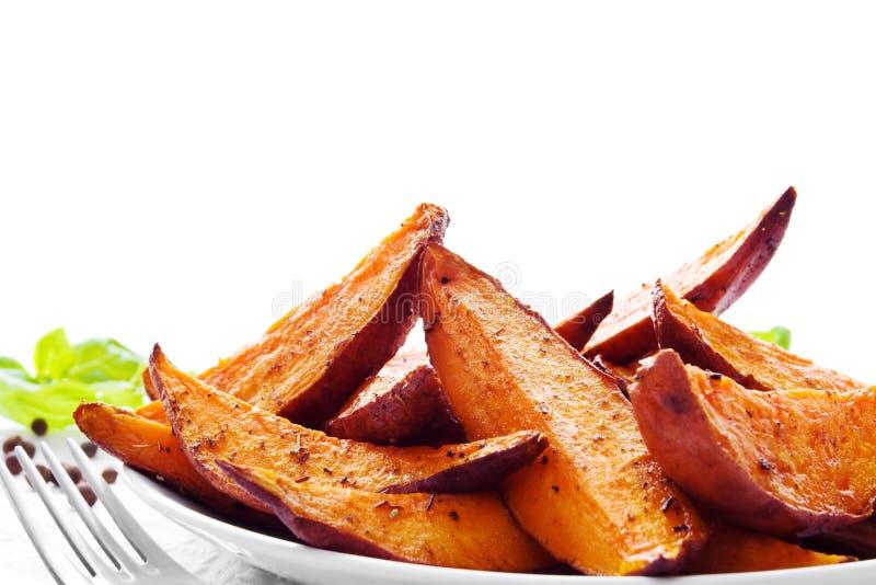 γλυκές σφήνες πατατών μερίδας στοκ εικόνες