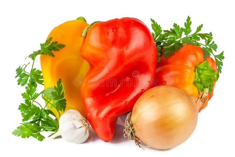 Γλυκό πιπέρι, κρεμμύδι, σκόρδο με τα πράσινα στοκ φωτογραφία