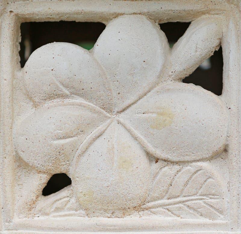 Γλυπτική πετρών λουλουδιών Frangipani στοκ φωτογραφίες με δικαίωμα ελεύθερης χρήσης