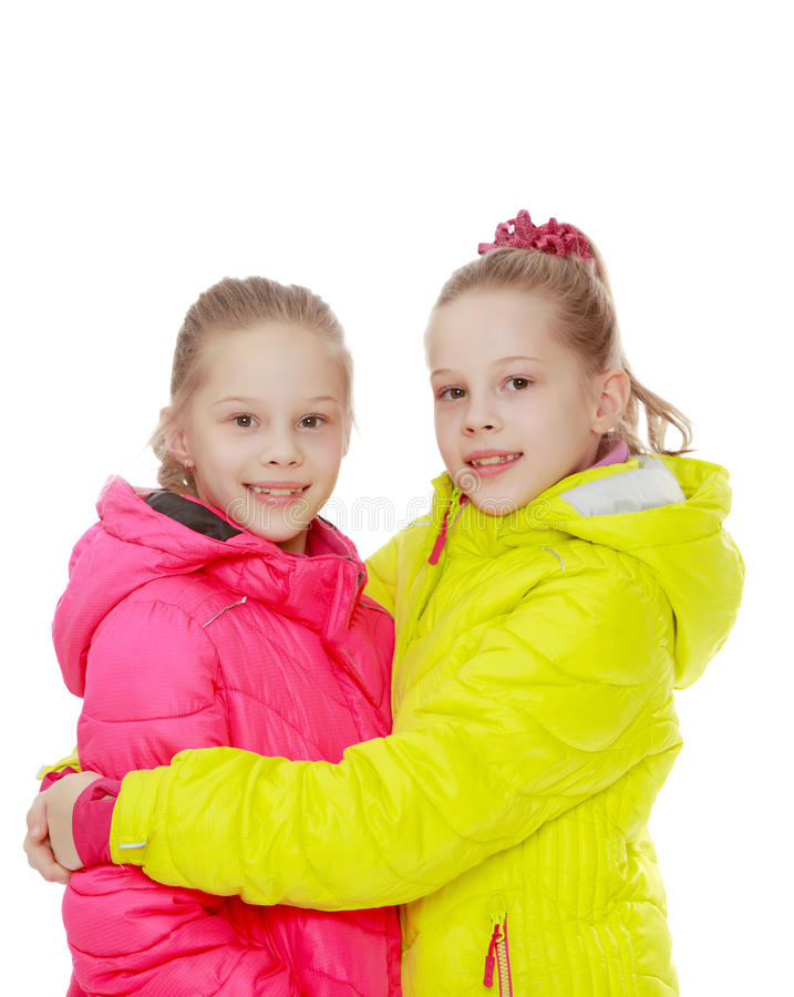 Γοητεία των δίδυμων κοριτσιών στα σακάκια στοκ φωτογραφία με δικαίωμα ελεύθερης χρήσης