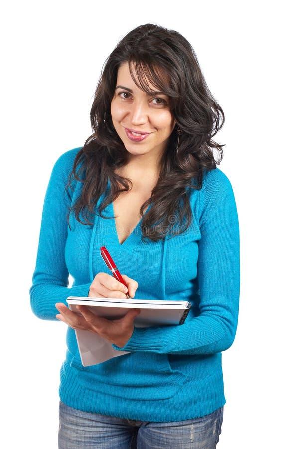 γράφοντας νεολαίες γυναικών σπουδαστών στοκ εικόνες