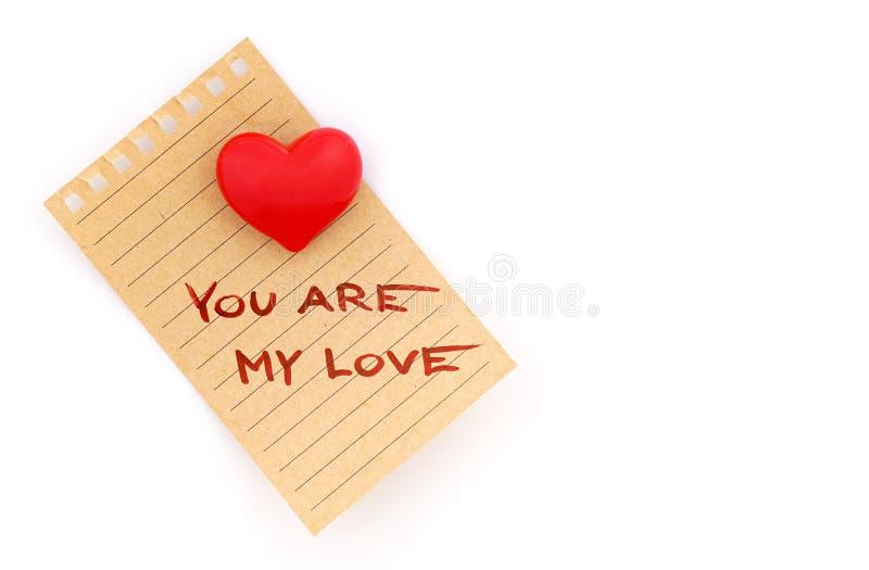 Γράψιμο από την αγάπη σε ένα φύλλο του εγγράφου στοκ φωτογραφίες