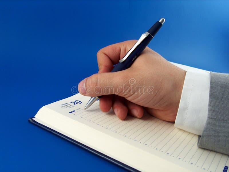 Download γράψιμο επιχειρηματιών στοκ εικόνα. εικόνα από χέρι, σημείωση - 110329