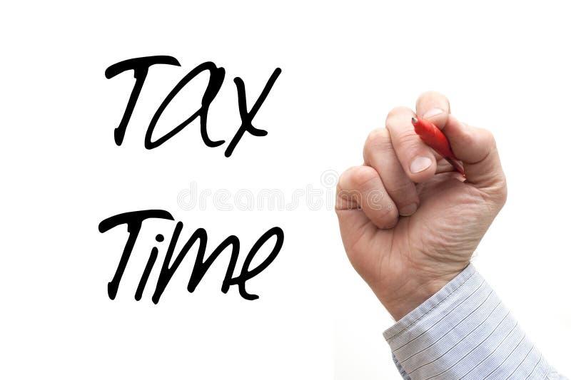 Γράψιμο «φορολογικός χρόνος» χεριών στοκ εικόνες