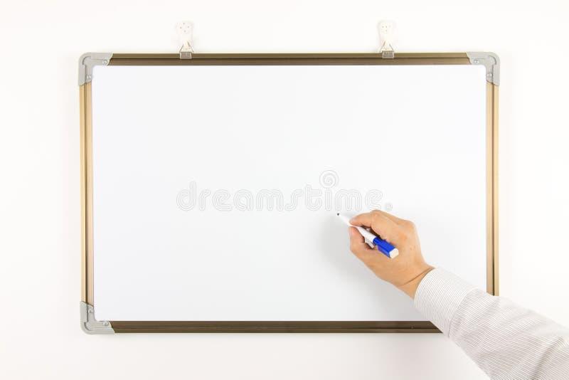 Γράψτε στο whiteboard στοκ εικόνα
