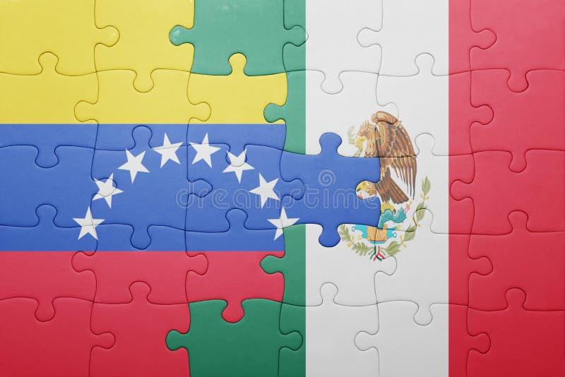 Γρίφος με τη εθνική σημαία της Βενεζουέλας και του Μεξικού στοκ φωτογραφίες