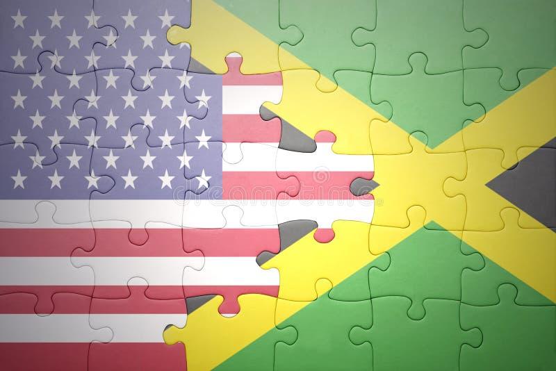 Γρίφος με τις εθνικές σημαίες των Ηνωμένων Πολιτειών της Αμερικής και της Τζαμάικας στοκ φωτογραφία