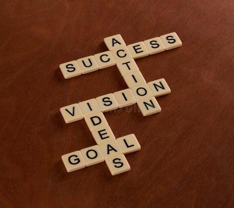Γρίφος σταυρόλεξων με το στόχο λέξεων, ιδέες, όραμα, δράση, επιτυχία στοκ εικόνες