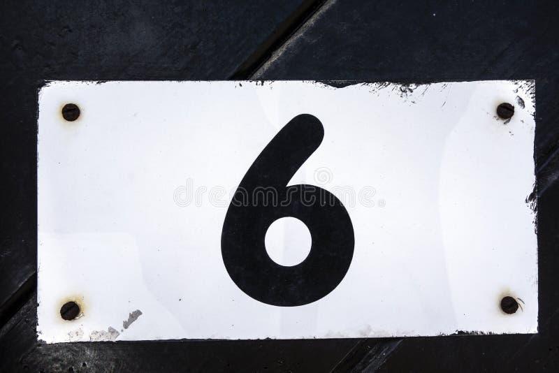 Γραπτή διατύπωση στο στενοχωρημένο κρατικό τυπογραφία αριθμό έξι 6 στοκ φωτογραφίες