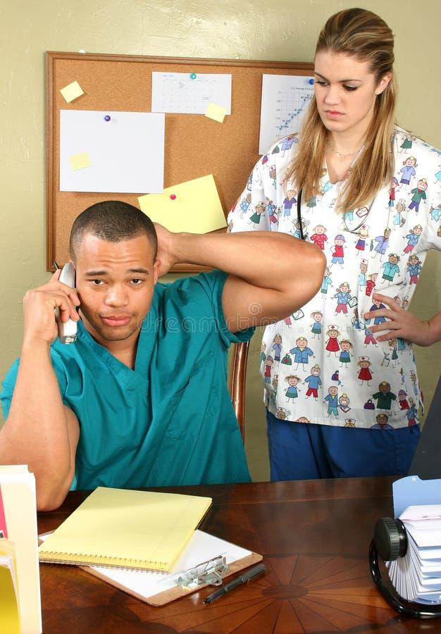 γραφείο νοσοκόμων γιατρώ&n στοκ φωτογραφία με δικαίωμα ελεύθερης χρήσης