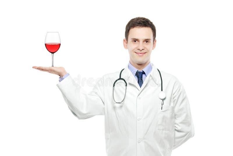 γυαλί γιατρών που κρατά τ&omicro στοκ φωτογραφία με δικαίωμα ελεύθερης χρήσης