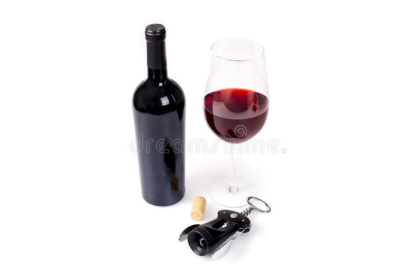 Γυαλί και μπουκάλι του κόκκινου κρασιού στην άσπρη ανασκόπηση στοκ φωτογραφία με δικαίωμα ελεύθερης χρήσης