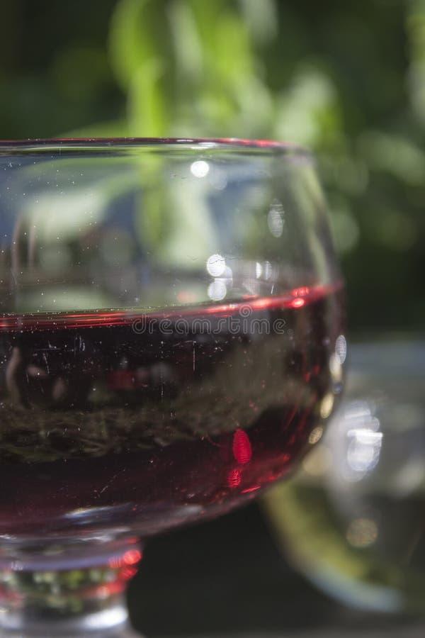Γυαλί ξιδιού κόκκινου κρασιού στοκ φωτογραφίες