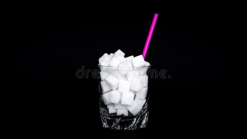 Γυαλί των κύβων ζάχαρης στοκ φωτογραφίες