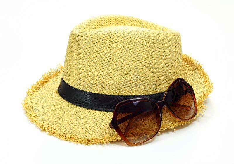 Γυαλιά καπέλων και ήλιων στοκ φωτογραφία με δικαίωμα ελεύθερης χρήσης
