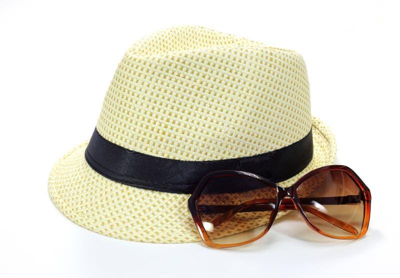 Γυαλιά καπέλων και ήλιων στοκ φωτογραφία