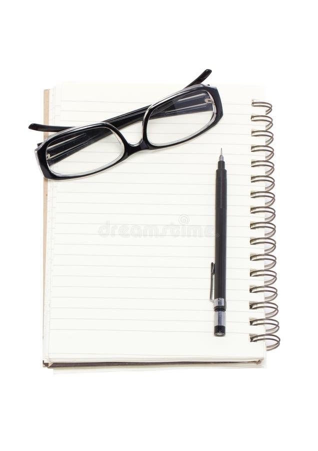 Γυαλιά ματιών με το μηχανικό σημειωματάριο μολυβιών και συνδέσμων. στοκ φωτογραφίες