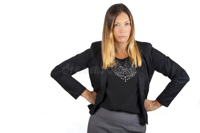 Γυναίκαη  επιθετική τοποθέτηση Στην άσπρη ανασκόπηση στοκ εικόνα με δικαίωμα ελεύθερης χρήσης