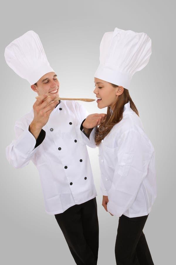γυναίκα ανδρών αρχιμαγείρ&o στοκ εικόνα με δικαίωμα ελεύθερης χρήσης
