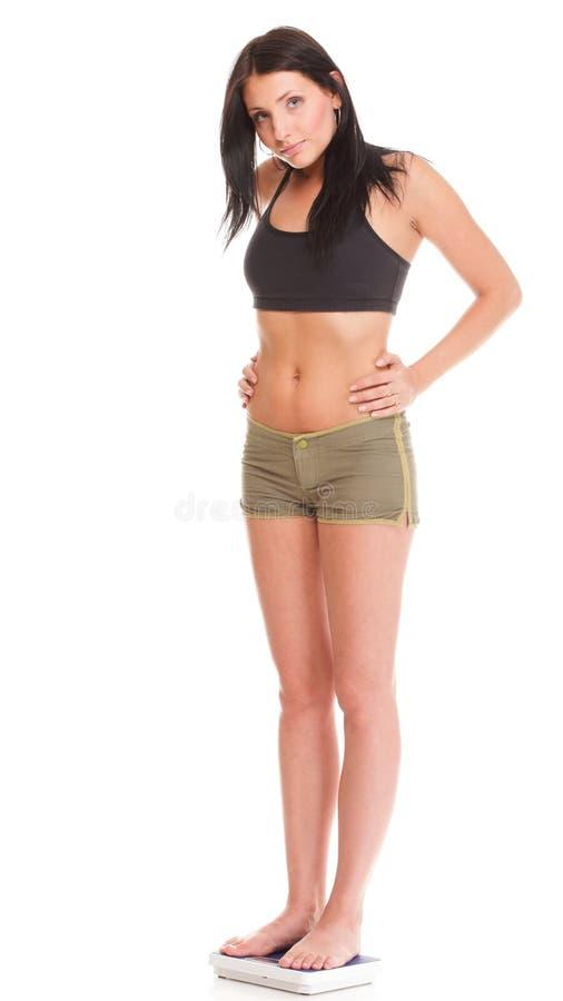 Γυναίκα απώλειας βάρους στην κλίμακα δυστυχισμένη στοκ φωτογραφίες