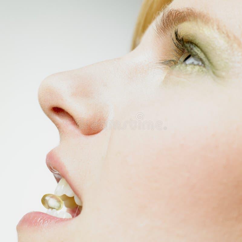 γυναίκα βιταμινών ε στοκ φωτογραφία