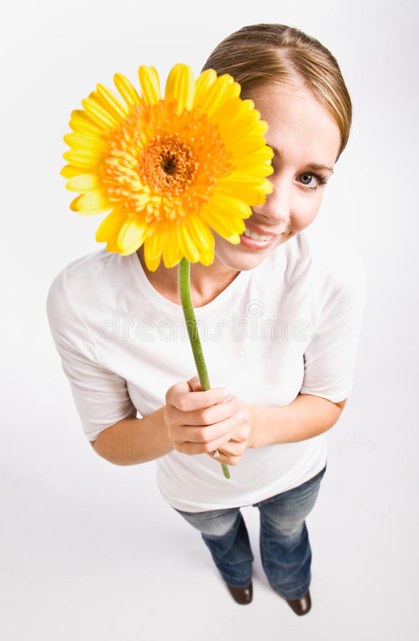 Download γυναίκα εκμετάλλευση&sigma στοκ εικόνες. εικόνα από λουλούδι - 17050288