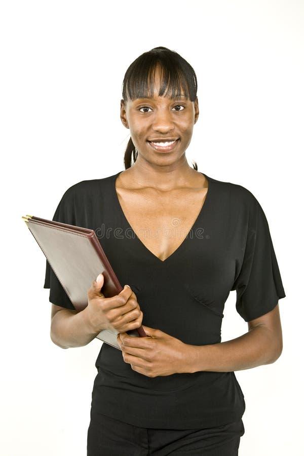 γυναίκα επιχειρησιακών σπουδαστών αφροαμερικάνων στοκ εικόνα