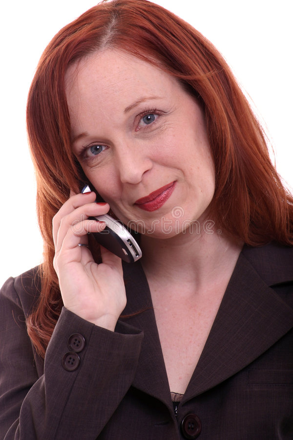 γυναίκα επιχειρησιακών τηλεφώνων στοκ εικόνα με δικαίωμα ελεύθερης χρήσης