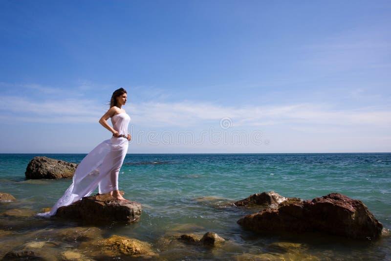 γυναίκα θάλασσας παραλ&io στοκ φωτογραφίες