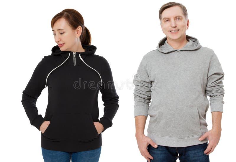 Γυναίκα και άνδρας που τίθενται κατά την μπροστινή άποψη μπλουζών Τύπος και θηλυκό στα hoody ενδύματα προτύπων για το διάστημα τυ στοκ εικόνα