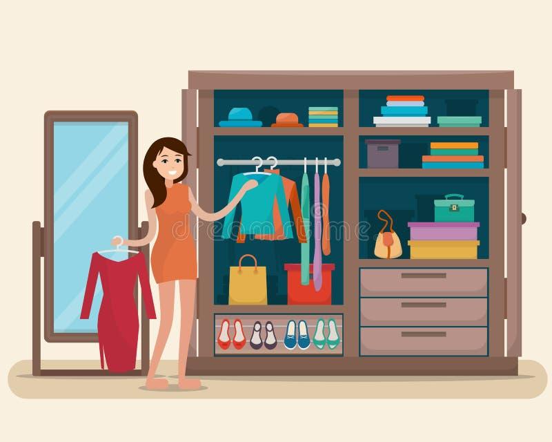 Γυναίκα κοντά στην ντουλάπα για τα υφάσματα με τον καθρέφτη απεικόνιση αποθεμάτων