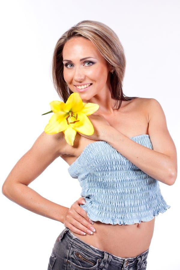 γυναίκα κρίνων λουλου&delta στοκ εικόνα με δικαίωμα ελεύθερης χρήσης