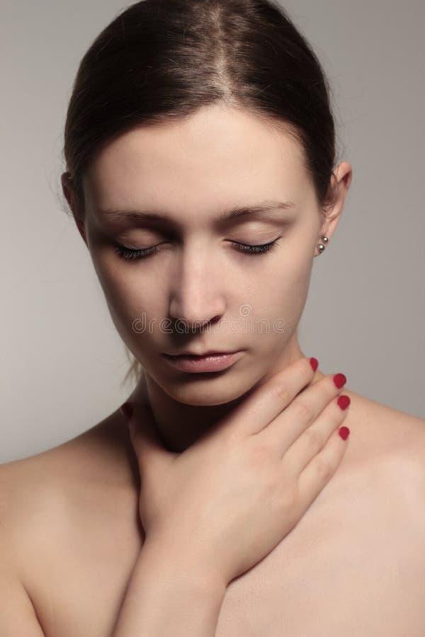 γυναίκα λαιμού εκμετάλλευσης στοκ εικόνες