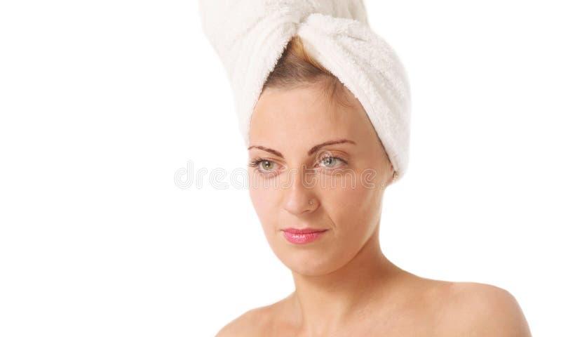 Γυναίκα με μια πετσέτα στοκ φωτογραφία