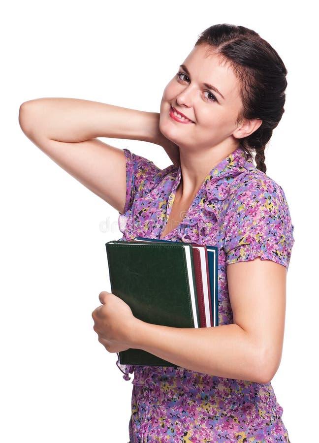 Γυναίκα με τα βιβλία στοκ φωτογραφίες