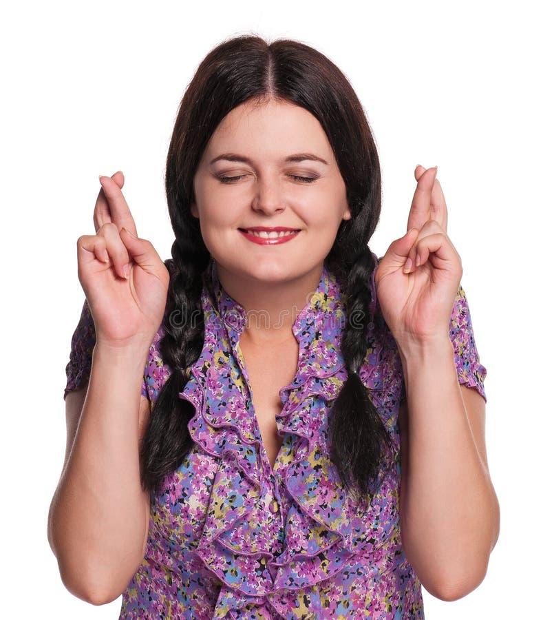 Γυναίκα με τα διασχισμένα δάχτυλα στοκ φωτογραφίες με δικαίωμα ελεύθερης χρήσης