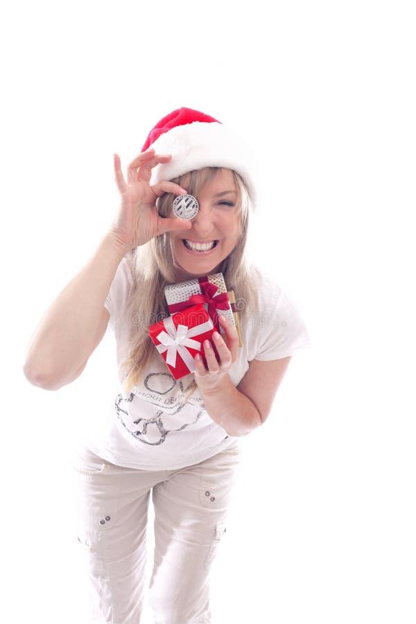 Γυναίκα με τα δώρα ενός Litecoin cryptocurrency και εκμετάλλευσης στοκ φωτογραφία με δικαίωμα ελεύθερης χρήσης