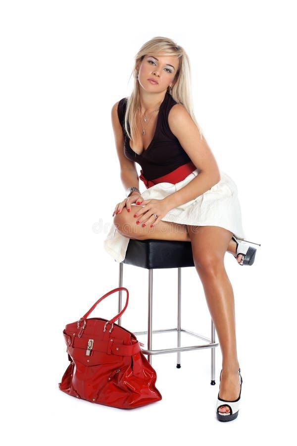 Γυναίκα με την κόκκινη τσάντα στοκ εικόνα