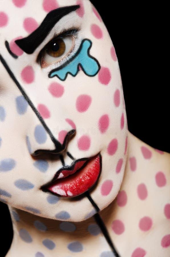 Γυναίκα με την τέχνη προσώπου στο πρόσωπο στοκ εικόνα με δικαίωμα ελεύθερης χρήσης
