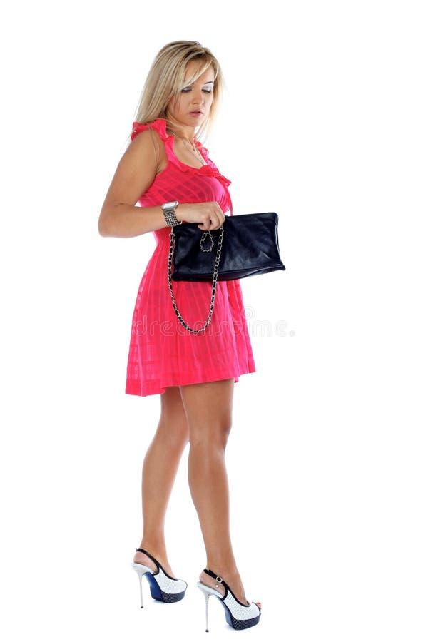 Γυναίκα με την τσάντα συμπλεκτών στοκ φωτογραφία με δικαίωμα ελεύθερης χρήσης
